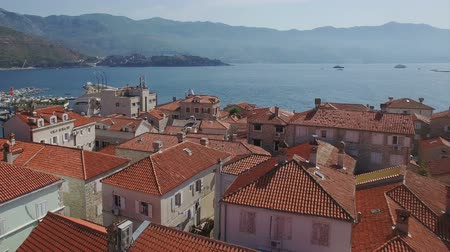 port n : Flying above the old town of Budva Montenegro towards the city beach, Budva Marina and Adriatic sea with Dukley Zavala on background. Aerial footage. Stock Footage