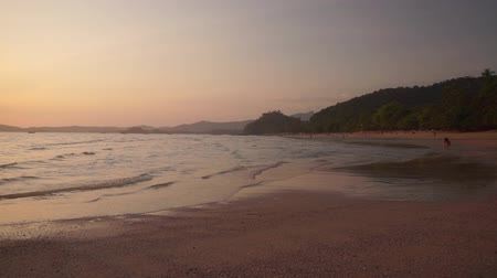 aonang : Beautiful beach Ao Nang in the province of Krabi at sunset. The warm waves of the Andaman Sea gently wash the sand of the beach in the evening. 50 frames per second full hd footage. Stock Footage