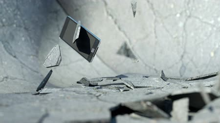 okos telefon : Smart phone falling down and smashing the concrete floor with slow motion. Alpha is included  Stock mozgókép