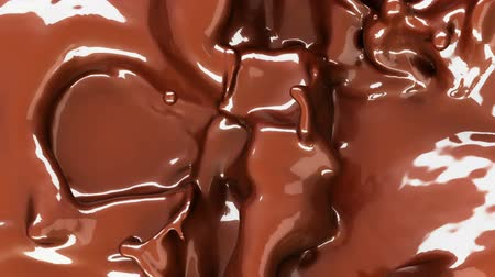 Hot chocolate or cocoa drink slow motion flow and splashes, alpha