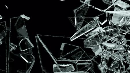 bullet : Pieces of destructed Shattered glass in slow motion. Alpha matte Stock Footage