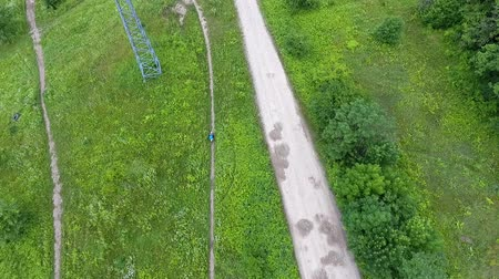 dirtbike : Top view of motorbike rider on green track. Stock Footage