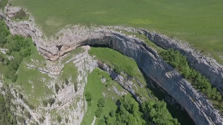 плато : Aerial view of the steep walls of the stone plateau.