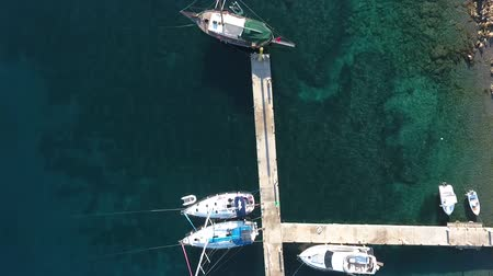 kotva : Sailing yachts are moored at the pier of the restaurant. Top view from drone.