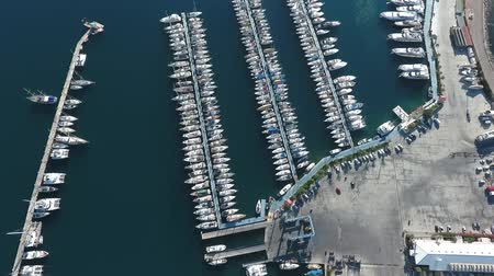 海港 : Footage from the drone. Flying over the marina for sailing yachts in the Mediterranean sea. 動画素材
