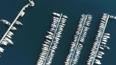 лодки : Footage from the drone. Flying over the marina for sailing yachts in the Mediterranean sea. Стоковые видеозаписи