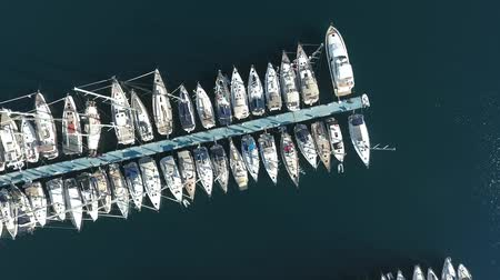 kruvazör : Many sailing yachts moored at the pier. Drone footage, top view.