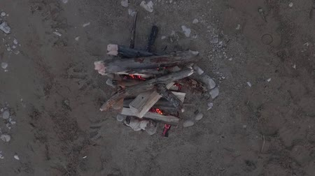 godo : Footage campfire on the sandy bank of the river. Top view.