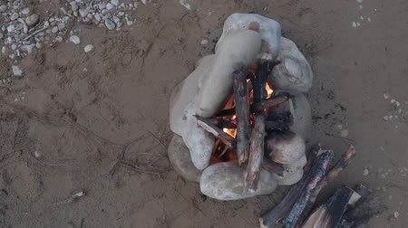 godo : Campfire on the sandy bank of the river. Top view.