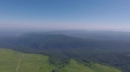 rural area : Beautiful natural live view from the drone. Mountain forest and clear sky. Stock Footage
