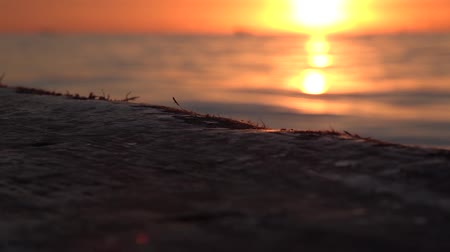 해적 : Wooden gunwale of sunset Slow motion video. Selective focus.
