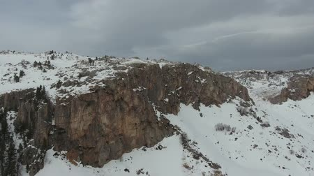 skalní útes : Aerial view of the steep slopes of rock formations. Drone flights in bad weather and snow.