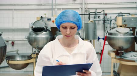 lab employee : Controller checking confection factory. Stock Footage