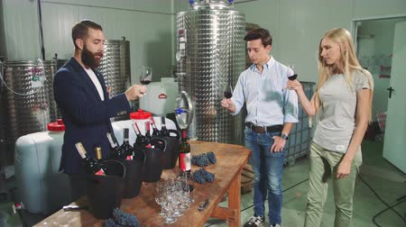 szőlőművelés : People degustating wine with sommelier.