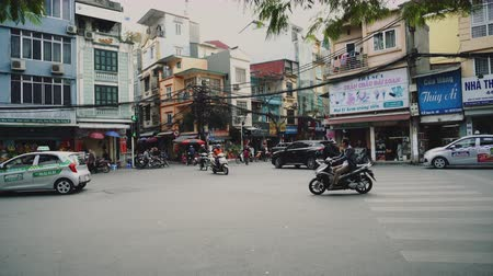 congested : Motorbikes and other traffic navigate through busy streets, Vietnam, Hanoi.