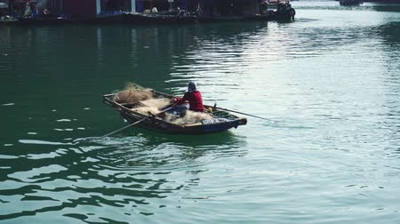 ba : Vietnamese Fishermen In The Boat At Ha Long Bay, Vietnam.