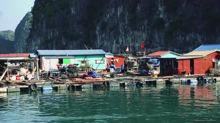 fishing village : Floating Fishing Village In The Ha Long Bay. Cat Ba Island, Vietnam Stock Footage