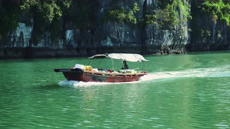 ba : Shot Of A Vietnamese Fishing Boat At Halong Bay Stock Footage