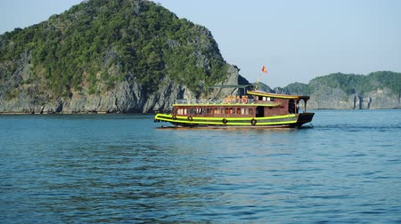 halong : Tourist Cruise Ship Boat In Lagoon Halong Bay, Cat Ba Island Vietnam Stock Footage