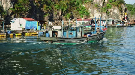ba : A Vietnamese Fishing Boat At The Base Of Cliffs In Halong Bay