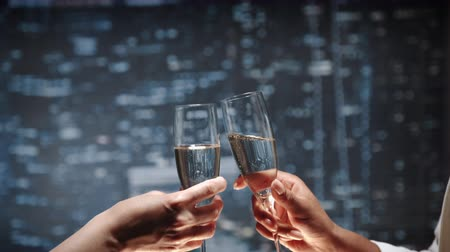 na zdraví : Close up of two hands with bocals of champagne making cheers and then drinking. Celebration of business success. Dostupné videozáznamy