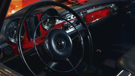 hız göstergesi : Steering wheel of classic retro or vintage car. Close-up Stok Video