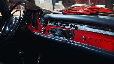 ステアリング : Dashboard panel of red retro car. Antique interior car