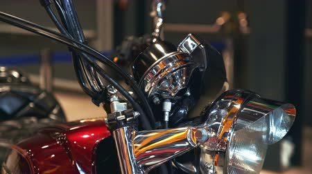 steering wheel : Front view of red retro motorcycle standing on the exhibition Stock Footage