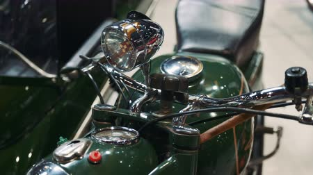 ステアリング : Close up of green motorcycle steering wheel and headlight. Retro style