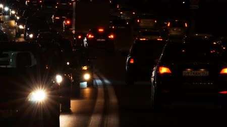 Night highway with traffic jam and emergency car