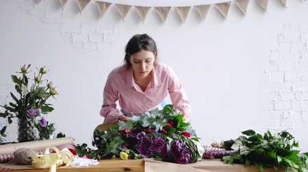 хрупкость : Florist check big modern bouquet of different flowers before sale