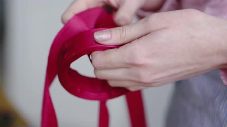 ustalık : Florist takes a ribbon in a flower shop to arrange a bouquet Stok Video