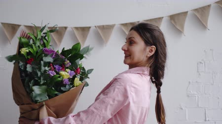 designing : Florist inspects a bouquet of different flowers Stock Footage