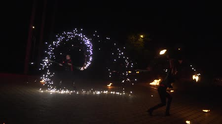 acrobata : Krasnodar, Russia - June 2, 2018: 2 people artists dance with fire, sparks from fire show Stock Footage