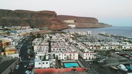 calming : Aerial forward view of little spanish port city Puerto Mogan, Gran Canaria