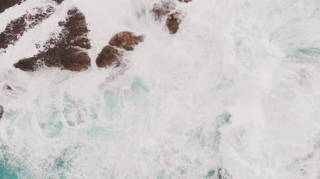 origin : Aerial view - a lot of sea foam near the shore of volcanic origin. Atlantic Ocean, Spain