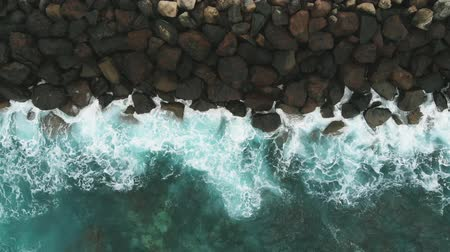 щит : Aerial view - shore protection black stones and the ocean of turquoise color. Gran Canaria, Spain