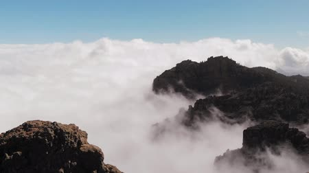 origin : Many beautiful clouds, mountains of volcanic origin, view from a height. Pico de las Nieves, Gran Canaria