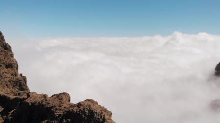 origin : Stunning aerial view of dense clouds beneath a rock of volcanic origin, Pico de las Nieves, Gran Canaria
