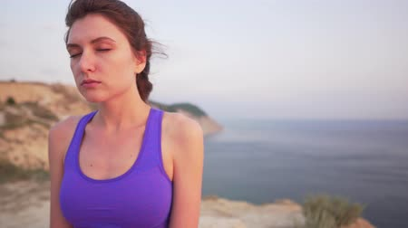 dech : Caucasian girl doing breathing practice - meditation in the morning by the ocean, closeup view Dostupné videozáznamy