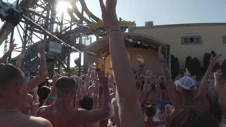 hapiness : Anapa, Russia - August 17, 2019: a lot of people are dancing and repeating the movement for the animators. Foam party at the aquapark slow motion Stock Footage