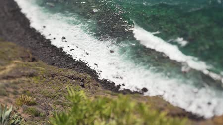 tilt shift : Beautiful ocean coast on a summer day, turquoise water and big waves, Tenerife, Spain Stock Footage