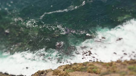 tilt shift : A beautiful view of the tropical coast of the sea - big waves crash onto the shore of the island in the ocean. Canary Islands