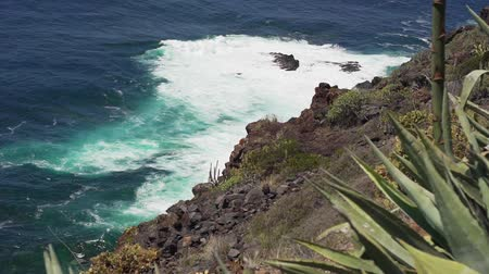 tilt shift : View of the coast of volcanic origin, the ocean and the waves of Tenerife Stock Footage