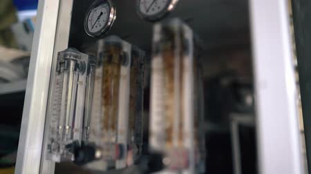 pneumatic : Measuring instruments in the laboratory close-up. Temperature indicator in a scientific study. Pressure Sensors and Valves Stock Footage