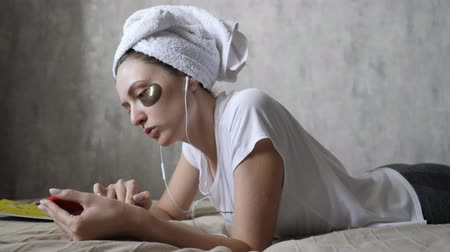 listening music : Natural skin care with bio cosmetics. Morning makeup, removing bruises under the eyes with the help of patches. Skin lifting around female eyes