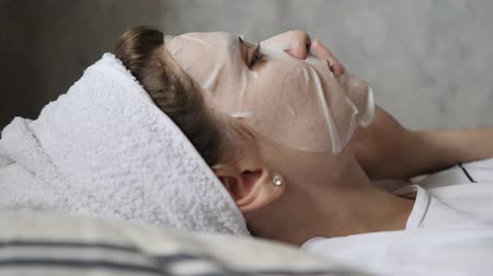 hazugság : A young woman in a moisturizing facial mask is resting and restoring her skin. Healthy lifestyle, cleansing face before going to bed