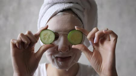 sheet : Portrait of a female mask, skin care cucumbers. Morning, fun and face hydration Stock Footage