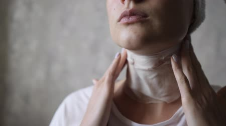 tomar : Young beautiful woman moisturizes her neck with a white mask. Natural skin treatment and therapy Stock Footage