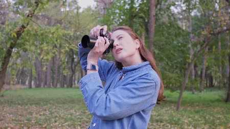 tomar : A professional photographer while working outdoors. Autumn Forest, Caucasian woman content creator